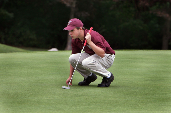 Gloucester: Jeff Piraino lines up his shot during the golf match against Gloucester at Bass Rocks Country Club Wednesday afternoon. Mary Muckenhoupt/Gloucester Daily Times