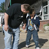 """Gloucester: Grant Harris comforts his son, Gavin Harris, 6, as they arrive at West Parish Elementary School for the first day of school yesterday morning. After Gavin found his first grade teacher, he started smiling, and said the tears he cried earlier were """"tears of joy."""" Photo by Kate Glass/Gloucester Daily Times Tuesday, September 1, 2009"""