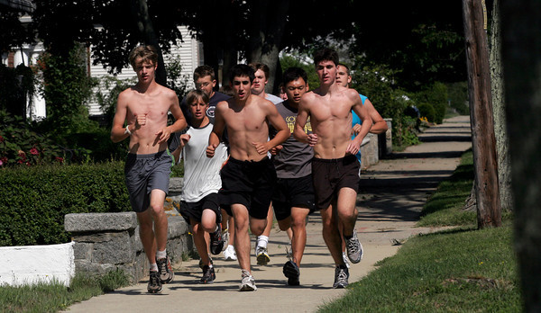 Manchester: The Gloucester boys cross country team runs down Western Ave as they head toward Ravenswood Park for practice. Photo by Kate Glass/Gloucester Daily Times Wednesday, September 2, 2009