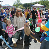 Gloucester: Chuck Karvelas makes a ballon sword for Rex LeClerc, 4, who is standing with his grandmother Debra Davidson and his cousins Jenna LeClerc, 6, and Sarah LeClerc, 9, left, during Stop and Shop's Cusomer Appreciation Day Saturday morning. Mary Muckenhoupt/Gloucester Daily times