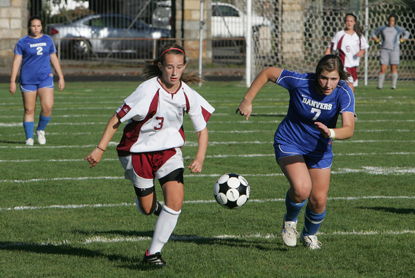 Gloucester: Gloucester forward Kali Cook, left, and Danvers forward Kelly Bates run for possession of the ball during the soccer game held at Newell Stadium Friday afternoon. Mary Muckenhoupt/Gloucester Daily Times