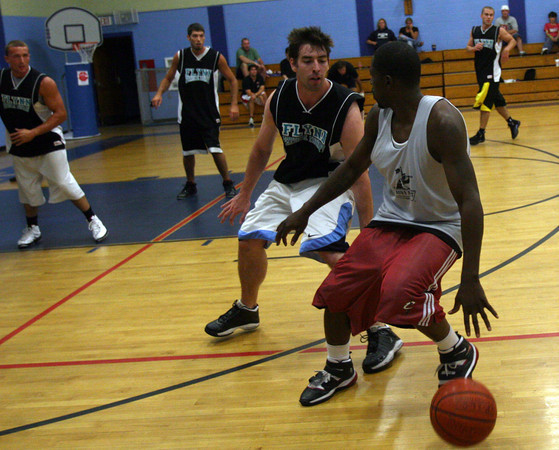Gloucester: Flynn's Physical Therapy's Tim Mahan guards Crow's Nest's Anthony Andersen during the Cape Ann YMCA Summer League Championship last night. Photo by Kate Glass/Gloucester Daily Times Tuesday, September 1, 2009