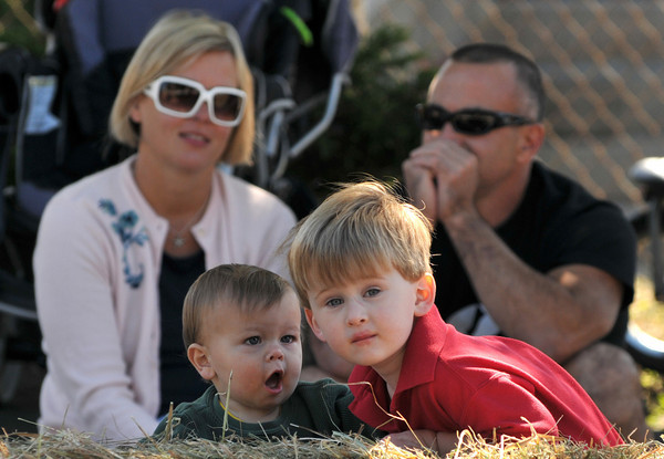 Gloucester: Seamus Linehan 9 months and Finn Wall 3,watch the race, with parents of Seamus, Kelly and Bruce Linehan behind them at the Fish Box Durby Sunday afternoon on Rodger St.Desi Smith Photo/Gloucester Daily Times. September 20,2009.