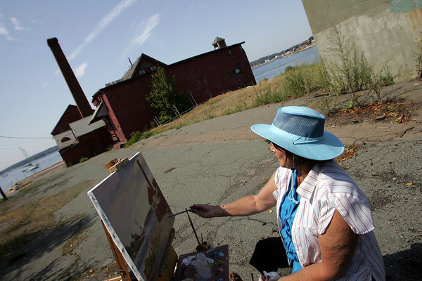 Gloucester: Sharon Bahosh paints Gloucester Harbor as seen form the Paint Factory Friday morning for the North Shore Art Association's Wet Paint Schooner Exhibition. The exhibit is being held from September 6th to the 13th at the North Shore Art Association. Bahosh had already painted the Bluenose II into the landscape and was hoping to add more schooners as they arrive.  Mary Muckenhoupt/Gloucester Daily Times