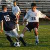 Gloucester: Gloucester's Kevin Hurd steals the ball from Winthrop's Samuel Brenner at Newell Stadium last night. Photo by Kate Glass/Gloucester Daily Times Monday, September 21, 2009
