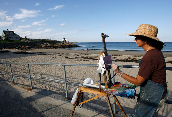 Rockport: Heidi Caswell Zander works on a painting of Front Beach yesterday afternoon as the sun dips low in the sky. Heidi shows her paintings at the Tidal Edge Gallery, which she runs, as well as Rocky Neck. Photo by Kate Glass/Gloucester Daily Times Tuesday, September 29, 2009