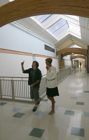 Manchester: Dylan Wolniewicz, left, and Karen Lucas talk about the arches inside the new Manchester Essex High and Middle School yesterday morning during the first day of school. Photo by Kate Glass/Gloucester Daily Times Wednesday, September 2, 2009
