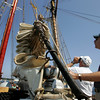 Gloucester: David Joyce, of Danvers, checks out the rigging aboard the Bluenose II while his friend Joe Farrell takes pictures as the public gets a chance to check out the schooner docked behind the Maritime Heritage Center Saturday afternoon. Mary Muckenhoupt/Gloucester Daily Times