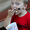 Essex: Zak Zindle, 3, of Gloucester eats a mouth full of popcorn during the annual Fall Festival at the Cox Reservation Saturday afternoon.  Mary Muckenhoupt/Gloucester Daily Times