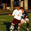 Gloucester: Gloucester's Marcos Rodrigues dribbles around Winthrop's DJ Estrada at Newell Stadium last night. Photo by Kate Glass/Gloucester Daily Times Monday, September 21, 2009