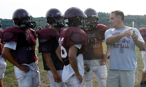 Gloucester assistant coach Michael Lattof shows the Fishermen their passing routes during drills. Photo by Kate Glass/Gloucester Daily Times Tuesday, September 8, 2009
