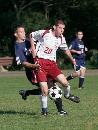 Rockport: Rockport's Andrew Visnick forces his way past Pope John's AJ Russell during their game at Rockport yesterday. Photo by Kate Glass/Gloucester Daily Times Tuesday, September 15, 2009