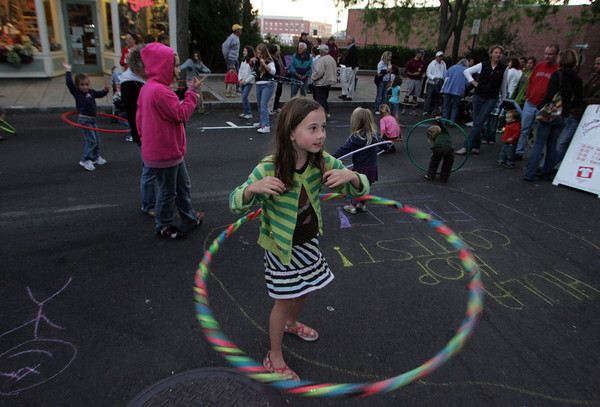 Gloucester: Aidan Cunningham, 8, practices her hoola hoop skills during the Block Party on Main Street Saturday evening. Mary Muckenhoupt/Gloucester Daily Times