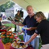 Rockport: Jessica Eddy and Al Eddy sample food from the buffet as   musicians Dave Vincent and John Hide perform at Den Mar Rehab during the opening ceremony for a new suite on Thursday. Gloucester Daily Times/Silvie Lockerova