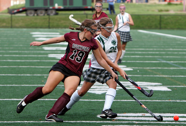 Manchester: Rockport's Emma Littlefield and Manchester Essex's Amelia Burke fight for possession of the ball during the field hockey game at Coach Ed Field Field Wednesday afternoon. Mary Muckenhoupt/Gloucester Daily Times
