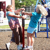 4th graders, Sarah Chambers and Heidrum Harriman, enjoy their first recess of the school year on one of the many fun structures on the playground at Rockport Elementary School yesterday. Photo by Maria Uminski/ Gloucester Daily Times