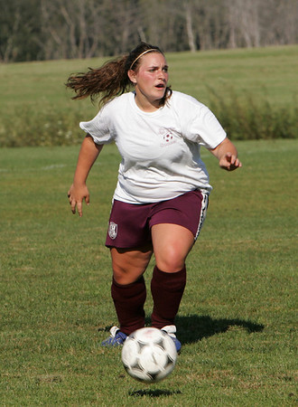 Gloucester:  Katina Tibbetts, one of the captains of the Gloucester gilrs varsity soccer team, runs for the ball during a scrimmage against Rockport at Magnolia Woods Thursday afternoon. Mary Muckenhoupt/Gloucester Daily Times