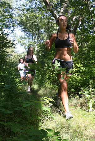 Manchester: Members of the Gloucester girls cross country team run through Ravenswood Park during practice on Tuesday. Photo by Kate Glass/Gloucester Daily Times Wednesday, September 2, 2009