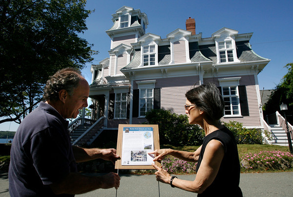 """Gloucester: James """"Gully"""" Hand and Judy Robinson-Cox look over the sign for the Rocky Neck Historic Art Trail in front of the Hopper's Mansard Roof House, which is one of 12 sites featured on the tour. Photo by Kate Glass/Gloucester Daily Times Monday, September 14, 2009"""