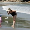 Gloucester: Maureen Castellana takes a momet to chat with Blakeley Robinson, 2, as the two cross paths while walking Wingaersheek Beach Friday afternoon. Mary Muckenhoupt/Gloucester Daily Times