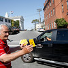 Gloucester: Dan Ruberti hands out stickers from Tally's Corner yesterday afternoon trying to urge residents to vote for him in the mayoral primary election. Photo by Kate Glass/Gloucester Daily Times Tuesday, September 29, 2009