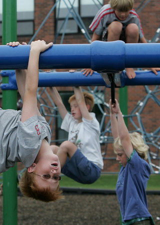 Rockport: Jon Dailey, 10, hangs upside down while playing with his friends at Amelia Grace Place playground behind Rockport High School Friday afternoon. Mary Muckenhoupt/Gloucester Daily Times
