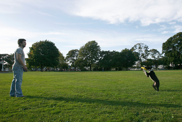 Manchester: Ben Johnson of Essex plays catch with his dog, Dory, at Masconomo Park on Monday. Johnson just moved to the area from California. Photo by Kate Glass/Gloucester Daily Times Monday, September 14, 2009