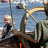 Gloucester: Patrick Jacobs checks out the rigging of the Bluenose II while his brother Matthew, 9, takes the wheel while touring the schooner with their dad Saturday afternoon.  The schooners Bluenose II and Unicorn were docked behind the Maritime heritage Center and offered free public tours as part of Maritime Heritage Day. Mary Muckenhoupt/Gloucester Daily Times