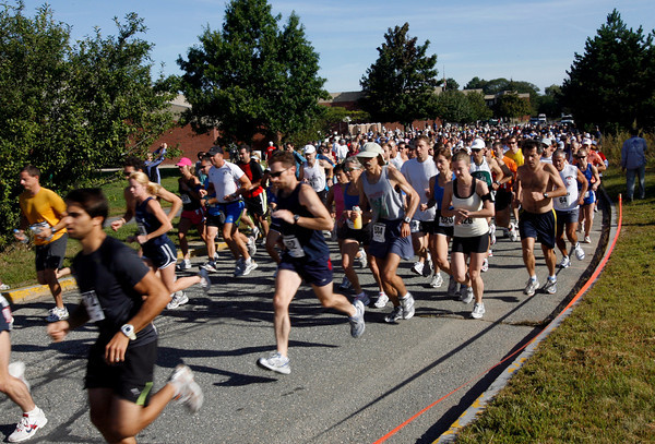 Gloucester: Runners head out from the O'Maley School for the 76th Around Cape Ann 25K Road Race yesterday morning. Photo by Kate Glass/Gloucester Daily Times Monday, September 7, 2009