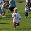 Gloucester: Emerson Marshall, 3, of Gloucester competes in the Children's Fun Run at the O'Maley School as part of the 76th Around Cape Ann Race, which benefits the Cape Ann YMCA. Marshall won the race for children age 4 and under. Photo by Kate Glass/Gloucester Daily Times Monday, September 7, 2009