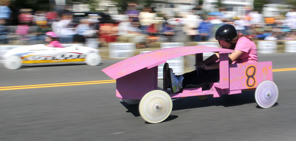 Gloucester: Fallon Queeney 12, in car#8 and Erricca Nolon 9, race past the crowd, in the modifide class in the Fish Box Durby Sunday afternoon on Rodger St.Desi Smith Photo/Gloucester Daily Times. September 20,2009.