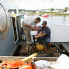 Manchester: Mark Chafey, left, and Jason Larochelle, right, change the oil in the Carey E while docked in Manchester Harbor on Tuesday. The boat takes 5 gallons of oil. Photo by Kate Glass/Gloucester Daily Times Tuesday, September 8, 2009