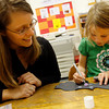 "Essex: Assistant Librarian April Wanner watches as Grace Gerhardt draws fangs on her bat at the T.O.H.P. Burnham Library on Wednesday afternoon. All the bats the kids made were hung on the ""Batty for Books"" bulletin board. Photo by Kate Glass/Gloucester Daily Times Wednesday, September 30, 2009"
