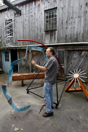 """Jay Havighurst plays """"Blue Arc,"""" one of five of his sound sculptures that will be at the 5th Gloucester New Arts Festival at Stage Fort Park on Saturday. Photo by Kate Glass/Gloucester Daily Times Tuesday, September 22, 2009"""