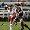 Gloucester: Gloucester's Erica Morse fights for possession of the ball with Revere's Racquel MacDonald during the field hockey game held at Newell Stadium Friday afternoon. Mary Muckenhoupt/Gloucester Daily Times