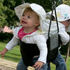 Manchester: Emily Logemann, 15 months, shares a swing with her twin sister Megan at Masconomo Park in Manchester. Mary Muckenhoupt/Gloucester Daily Times