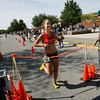 Gloucester: Tara Wommack is the first female to cross the finish line of the 76th Around Cape Ann 25K Road Race yesterday morning. Photo by Kate Glass/Gloucester Daily Times Monday, September 7, 2009