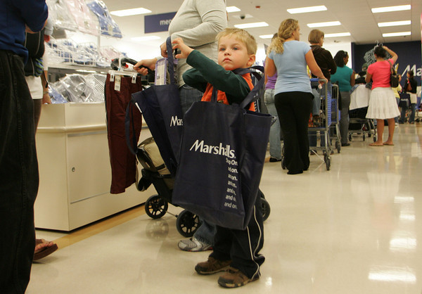 Gloucester: Ethan Mahony, 3, of Gloucester waits patiently in line with his mother as a long line waits for check out at Marshalls Thursday morning.  Many shoppers couldn't wait in the long lines so they put their future purchases on hold in hopes of coming back at a less busier time.  Mary Muckenhoupt/Gloucester Daily Times