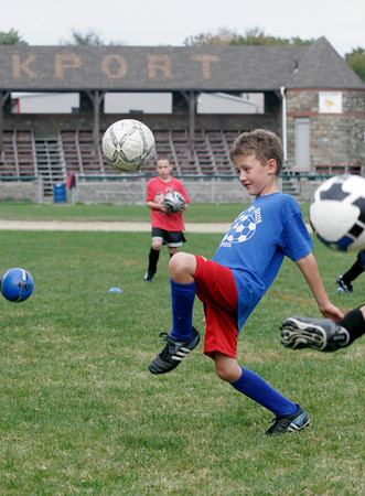 Rockport: Andrew Guelli, 7, tries to juggle the soccer ball during Rockport Youth Soccer practice at Evans Field Tuesday night. The kids play games every Saturday. Photo by Kate Glass/Gloucester Daily Times Tuesday, September 22, 2009
