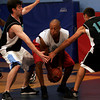 Gloucester: Flynn's Physical Therapy's Tim Mahan, left, and Bob Shatford, right, try to block Crow's Nest's Rob Breckenridge during the Cape Ann YMCA Summer League Championship last night. Photo by Kate Glass/Gloucester Daily Times Tuesday, September 1, 2009