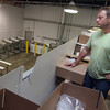 Gloucester: Kristian Kristensen, CEO of Zeus Packing Inc., looks out over the empty room where his employees used to filet dogfish. Recent fishery closures have forced the company to lay off over 70 employees. Photo by Kate Glass/Gloucester Daily Times