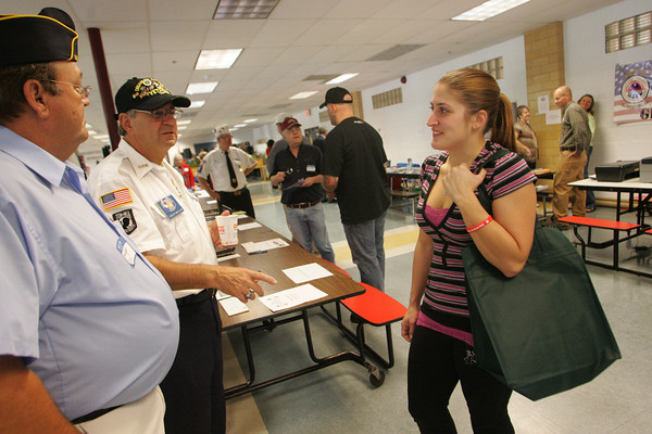 Gloucester: Michelle O'Neil, of Gloucester, who was in the U.S. Marine Corps. talks with Tom Dagle, left, and Sam Calomo, members of the Disabled American Veterans during the Veterans Services Fair at Gloucester High School Saturday morning.   Mary Muckenhoupt/Gloucester Daily Times