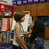 Manchester: Mary Callahan hugs her mom, Lisa Callahan, as she explores her kindergarten classroom at Manchester Memorial Elementary School yesterday morning. Photo by Kate Glass/Gloucester Daily Times
