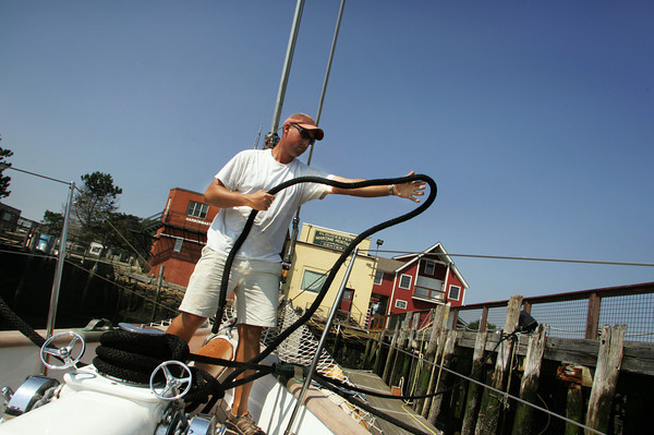 Gloucester: Jonathan Kabak, captainn of the Summerwind, doubles up on dock lines and adds chafe gear as he prpeares the schooner for whatever hurricane Earl has in store behind the Maritime Heritage Center Thursday afternoon.  The boat breaking free of it's lines would be a worst case scenario