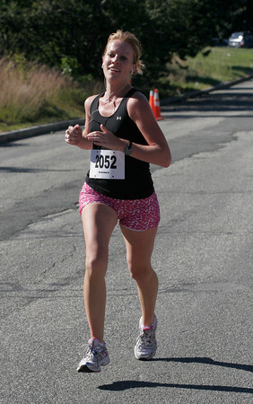 Gloucester: Annie Rose Willis of Danvers was the first female to cross the finish line of the Run the Goose 7K yesterday morning. Photo by Kate Glass/Gloucester Daily Times