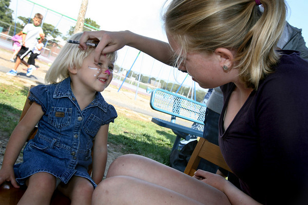 Rockport: Lizzy Mahady, 2, gets her face painted by Sarah Rowen at the Rockport Public Schools Block Party on Sunday. The event featured games, contests and food as well as face painting and henna tattoos. Photo by Kate Glass/Gloucester Daily Times