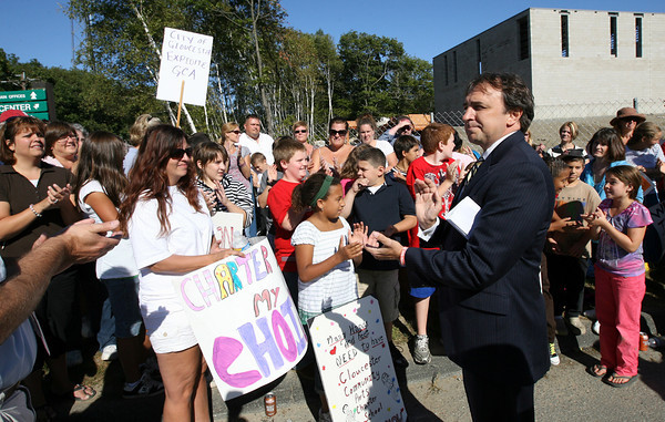 Gloucester: Tony Blackman, Executive Director for the Gloucester Community Arts Charter School, addresses nearly 100 parents and children who held a rally at the school's Blackburn site yesterday in support of the school opening. Photo by Kate Glass/Gloucester Daily Times