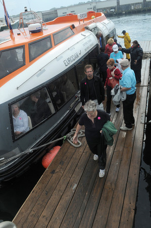Gloucester:  Passengers from the cruise ship Eurodam exit the water taxi at Cruise Port Wednesday morning. Desi Smith/Gloucester Daily Times. September 8,2010