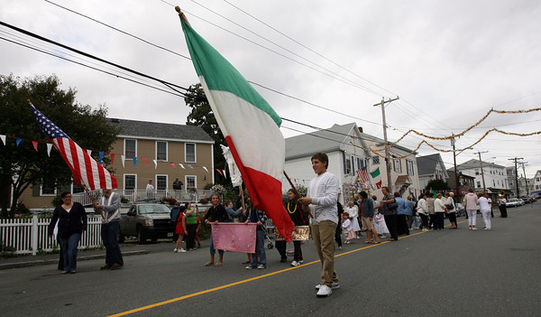 Gloucester: Michael Russo, holding the Italian flag, leads the Mother of Grace Club Parade down Washington Street on Sunday, the final day of their annual fiesta. Photo by Kate Glass/Gloucester Daily Times