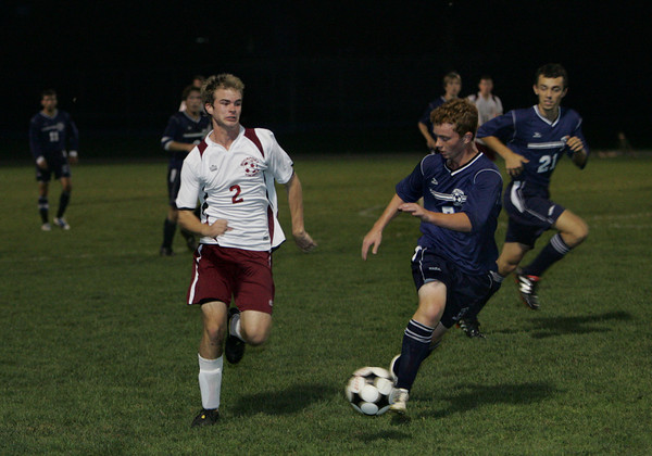 Rockport: Rockport's Sam Scatterday, left, runs for possession of the ball alongside Triton's Jackson Shelter during the soccer game at Rockport High School Wednesday night. Mary Muckenhoupt/Gloucester Daily Times